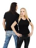 Pares con las camisas negras en blanco Foto de archivo libre de regalías