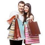 Pares con los bolsos de compras Fotos de archivo libres de regalías