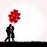 Pares con los globos Foto de archivo libre de regalías