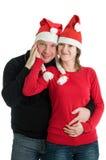 Pares con los sombreros de Santa Imagen de archivo
