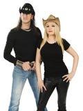 Pares con los sombreros de vaquero y las camisas negras en blanco Foto de archivo libre de regalías