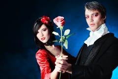 Pares con una rosa Foto de archivo libre de regalías