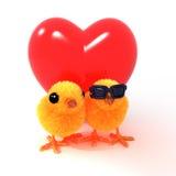 pares 3d de polluelos de Pascua delante del corazón rojo Fotos de archivo