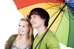 Pares da raça misturada sob o guarda-chuva Foto de Stock Royalty Free