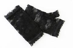 Pares das mulheres de luvas pretas do laço em um branco Fotos de Stock