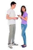 Pares de adolescente con smartphone Fotografía de archivo