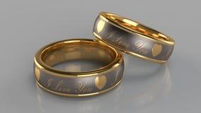 Pares de anéis dourados Foto de Stock