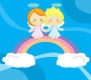 Pares de anjos pequenos bonitos Imagens de Stock