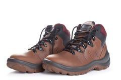 Pares de botas de trabalho marrons no branco Fotografia de Stock Royalty Free