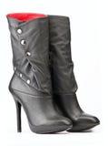 Pares de cargadores del programa inicial femeninos negros con la guarnición roja Imagen de archivo libre de regalías