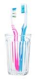 Pares de cepillos de dientes en vidrio Foto de archivo libre de regalías