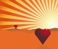 Pares de corazones en el sol de levantamiento Imagen de archivo