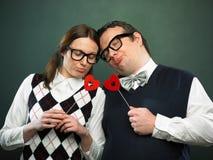 Pares de empollones en amor foto de archivo libre de regalías
