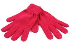 Pares de guantes de lana para la mujer en el fondo blanco Foto de archivo