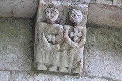 Pares de guerreros medievales en la ménsula de la abadía de Arthous fotografía de archivo libre de regalías