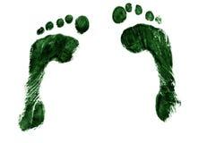 Pares de huellas verdes Imagenes de archivo