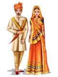 Pares de la boda de Rajasthani en el traje tradicional de Rajasthán, la India Imagen de archivo