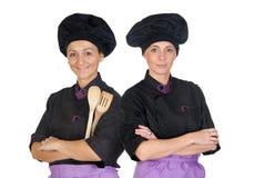 Pares de las mujeres de los cocineros con el uniforme negro Fotos de archivo libres de regalías