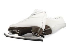 Pares de patines blancos Fotografía de archivo