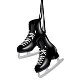 Pares de patines de hielo negro en blanco Foto de archivo