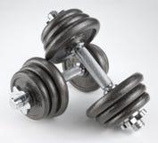 Pares de pesas de gimnasia pesadas Fotografía de archivo libre de regalías