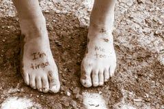 Pares de pies cansados Imagen de archivo libre de regalías