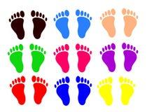 Pares de pies de colores Fotografía de archivo