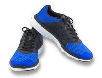 Pares de sapatas azuis do esporte no fundo branco Imagens de Stock