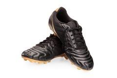 Pares de sapatas de couro pretas do futebol imagens de stock