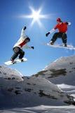 Pares de snowboarders imagem de stock royalty free