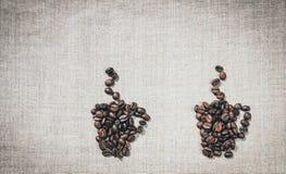 Pares de tazas de café El menú de la decoración en el café Imagen de archivo libre de regalías