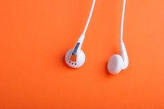 Pares de teléfonos del oído Imágenes de archivo libres de regalías