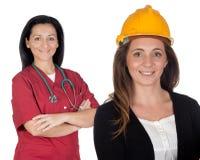 Pares de trabalhadores de mulheres fotos de stock royalty free