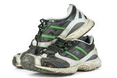 Pares de zapatillas de deporte gastadas Fotografía de archivo