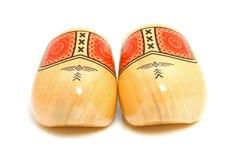 Pares de zapatos de madera amarillos holandeses tradicionales Imágenes de archivo libres de regalías