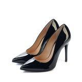 Pares de zapatos negros de la obra clásica de las mujeres de los tacones altos Foto de archivo