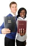 Pares del asunto que soportan las biblias Imagenes de archivo
