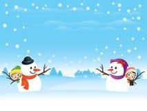 Pares del muñeco de nieve con los cabritos Imagen de archivo libre de regalías