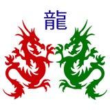 Pares del símbolo de silueta de los dragones, en el fondo blanco Imágenes de archivo libres de regalías