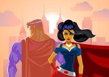 Pares del super héroe: Super héroes masculinos y femeninos Fotos de archivo libres de regalías