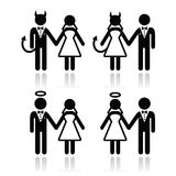 Pares do casamento - ícones do diabo e dos noivos do anjo Fotografia de Stock