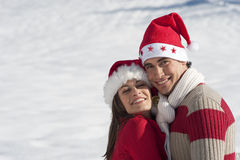 Pares do Natal no amor fotografia de stock royalty free