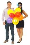 Pares do partido com balões Imagem de Stock Royalty Free
