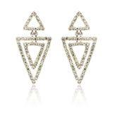 Pares dos brincos de prata do diamante isolados no branco imagens de stock royalty free