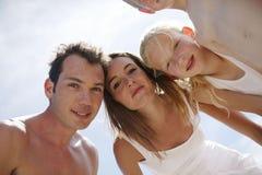 Pares e crianças novos Fotografia de Stock Royalty Free