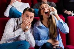 Pares e outros povos no cinema Imagem de Stock Royalty Free
