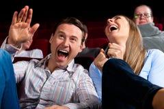 Pares e outros povos no cinema Fotografia de Stock Royalty Free