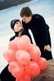 Pares en amor con las bolas Foto de archivo