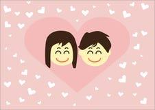 Pares en amor con los corazones Foto de archivo libre de regalías