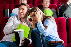 Pares en cine Imagen de archivo libre de regalías